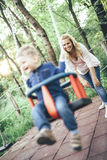 Mother swinging her child outdoor Royalty Free Stock Photography
