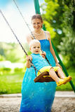 Mother swinging her son Royalty Free Stock Photography