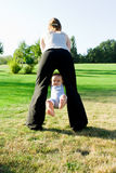 Mother swinging  little baby Royalty Free Stock Image