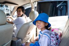 Mother Take Her Little Daughter By Car Going To School Stock Photo