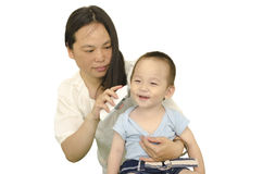 Mother taking boy's temperature Royalty Free Stock Photo