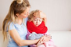 Mother taking care of her sick child Royalty Free Stock Photography