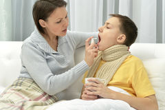 Mother taking care of son. Mother taking care of ill son at home Stock Photos
