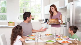 Mother taking chicken dish to her family Stock Images