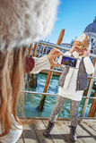 Mother taking photo of child wearing Venetian mask, Venice Stock Photography