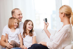 Mother taking picture of father and daughters Royalty Free Stock Images