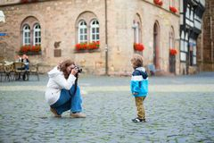 Mother taking picture of her son Royalty Free Stock Photo