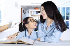 Mother talking with her child while teaching Royalty Free Stock Photo