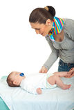 Mother talking with her newborn baby Stock Image