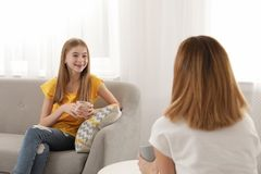 Mother talking with her teenager daughter stock photography