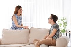 Mother talking with her teenager son stock image