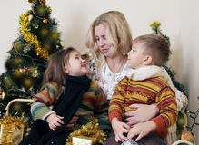 Mother talking with her two children about Christmas Royalty Free Stock Photo