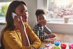 Mother talking on phone forgetting child Stock Photo
