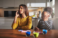 Mother talking on phone forgetting child Stock Images