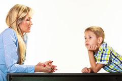 Mother talking with son. Children upbringing. Royalty Free Stock Images
