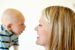Mother talking to baby Stock Photo