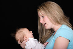 Mother Talking to Daughter. A mother talks to her baby daughter Royalty Free Stock Photos