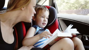 Mother talking to son while they in the car Royalty Free Stock Photos
