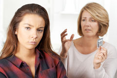 Mother Talking To Teenage Daughter About Contraception Royalty Free Stock Image