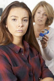Mother Talking To Teenage Daughter About Dangers Of Smoking Royalty Free Stock Photography