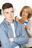 Mother Talking To Teenage Son About Dangers Of Smoking Stock Image