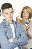 Mother Talking To Teenage Son About Dangers Of Smoking Royalty Free Stock Image