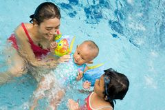 Mother teach baby to swim Royalty Free Stock Photo