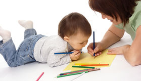 Mother teach her child to draw. White background royalty free stock photography