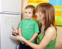 Mother teaches child Stock Image