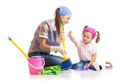 Mother teaches child cleaning room Royalty Free Stock Photo