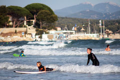Mother teaches child to surf on the beach, La Ciotat, France Royalty Free Stock Photos