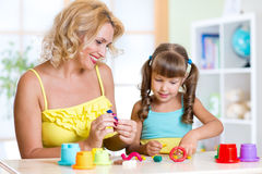 Mother teaches child to work with colorful play Stock Image