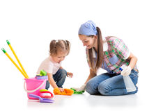 Mother teaches daughter child cleaning room Stock Photos