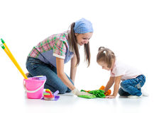 Mother teaches daughter child cleaning room Royalty Free Stock Image