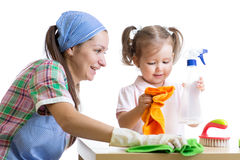 Mother teaches daughter child cleaning room Stock Photography