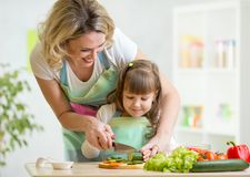 Mother teaches daughter cooking on kitchen Stock Photography