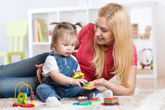 Mother teaches her child to distinguish shape and Stock Photo