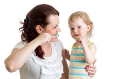 Mother teaches her daughter kid teeth brushing Stock Photos