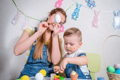 Mother teaches kid to do craft items Royalty Free Stock Image