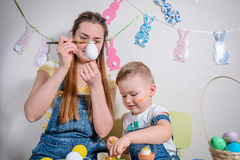 Mother teaches kid to do craft items Stock Photo