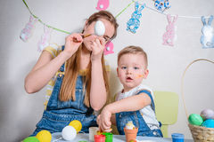 Mother teaches kid to do craft items Royalty Free Stock Images