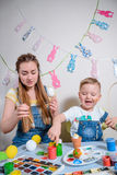 Mother teaches kid to do craft items Royalty Free Stock Photography