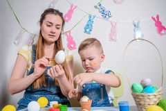 Mother teaches kid to do craft items stock photos