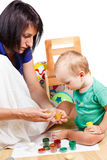Mother teaches the kid to paint colors Royalty Free Stock Photo