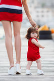 Mother teaches little daughter to walk alone Royalty Free Stock Photos