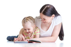 Mother teaches reading book to child Royalty Free Stock Images