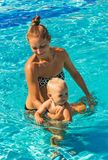 Mother teaches young son to swim Royalty Free Stock Photo