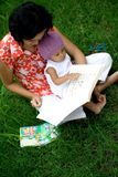 Mother teaching baby with books Royalty Free Stock Photos