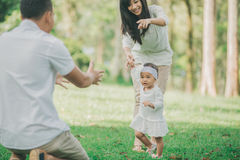 Mother teaching baby to walk in the park royalty free stock image