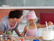 Mother teaching Child how to cook royalty free stock photos